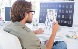 Photo editor examining contact sheet Stock Photo