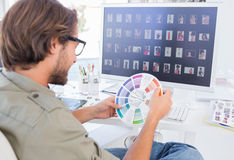 Photo editor looking at colour wheel Royalty Free Stock Photo