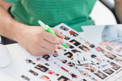Photo editor marking contact photographs Stock Images
