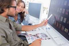 Photo editor pointing at thumbnail on screen Royalty Free Stock Images