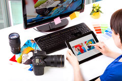 Photo editor working on computer. Royalty Free Stock Photos