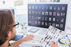 Photo editor working on the contact sheet Stock Images