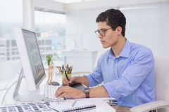 Photo editor working at his desk Royalty Free Stock Photo