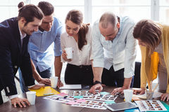 Photo editors looking at photos on table. In creative office Royalty Free Stock Photo