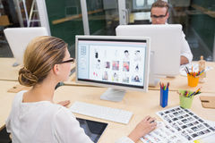 Photo editors using computers in office Royalty Free Stock Images