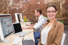 Photo editors using computers in office Stock Photo