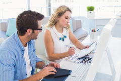 Photo editors working with graphic tablet and notepad. In office Stock Images