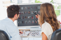 Photo editors working on thumbnails Stock Photos