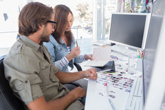 Photo editors working together. At desk in bright modern office Stock Photos