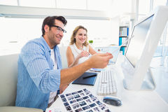 Photo editors working together on graphics tablet Royalty Free Stock Photos