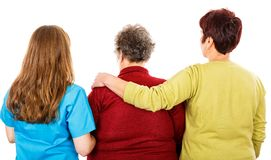 Elderly woman and young caregivers. Photo of elderly women and young caregivers Royalty Free Stock Photo