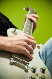 Photo of an electric guitar being played. Stock Images