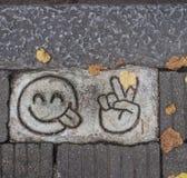 Emoji on the asphalt royalty free stock photography