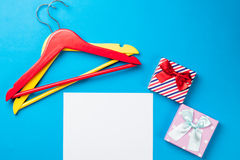 Photo of empty sheet of paper, cute gifts and hangers on the won Stock Photography