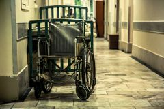 Photo of an empty wheelchair in the hospital room royalty free stock photography