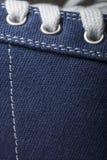 Photo en gros plan de fond de texture d'espadrilles de jeans Images stock