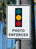Photo Enforced Traffic Light Sign. Photo Enforced traffic light warning sign in sunny Beverly Hills California Stock Photo
