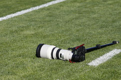 Photo equipment on green grass. Professional photo equipment abandoned on grass royalty free stock photo