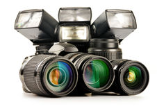 Photo equipment including zoom lenses, camera and flash lights Stock Photography