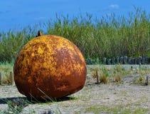 The eroded iron ball. Photo of an eroded iron ball in a garden - Póvoa de Santa Iria - Vila Franca de Xira - Portugal - March 2017 Royalty Free Stock Photos