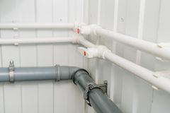 The photo of the established plastic pipes for water supply stock photos
