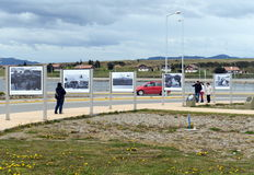 Photo exhibition about the Falklands war in the area of Malvinas Islands in Ushuaia. USHUAIA, ARGENTINA - NOVEMBER 17,2014: Photo exhibition about the Falklands Royalty Free Stock Photography