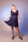 Photo of expectant mother in a dark blue dress Royalty Free Stock Photos