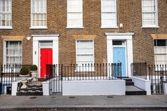 Traditional British Terraced Houses with Colourful Doors royalty free stock photography