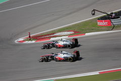 Photo F1 : Dépassement de McLaren de voiture de course de formule 1 Photographie stock
