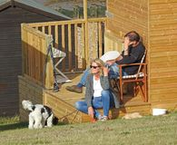 Beach hut holidaymakers. Photo of family and dog enjoying their summer holiday at their beach hut tankerton whitstable oct 2017 Royalty Free Stock Photos