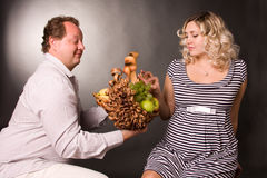 Photo of family pair with the basket of fruit Stock Photography