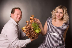 Photo of family pair with the basket of fruit Stock Photos