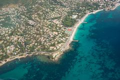 Seashore from birds eye view. Photo of fascinating seashore, colourful buildings and green trees taken from the birds eye view. Travel concept Stock Photo