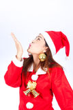 Photo of fashion Christmas Asain girl blowing something. Stock Photo