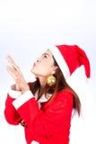 Photo of fashion Christmas Asain girl blowing something. Stock Photos