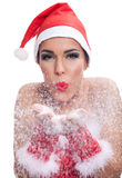 Photo of fashion Christmas girl blowing snow Stock Image