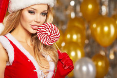 Photo of fashion Christmas girl over golden balloons Royalty Free Stock Image