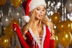 Photo of fashion Christmas girl over golden balloons Stock Photo