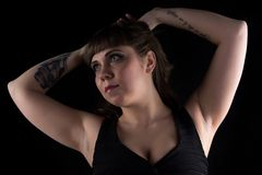 Photo of fat woman with tattoo on hand stock photo