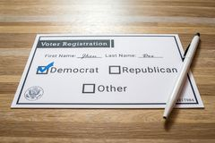 Voter registration card with Democratic party selected. Photo of a faux voter registration form signifying that a person is joining the democratic party Royalty Free Stock Images
