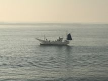 Japanese boat in the ocean in Japan royalty free stock image