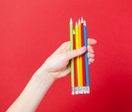 Photo of female hand holding colorful pencils on the wonderful r Stock Photos