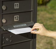 Sending letter to outgoing postal mailbox Stock Image