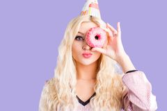 Photo of female holds sweet delicious doughnut stock image