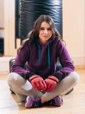 Photo of female kickboxer,having break in training stock photos