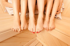 Photo of female and two girls legs at sauna Royalty Free Stock Image