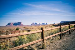 A photo of a fence overlooking the Sedona Monument Valley. A photo of the Sedona Monument Valley in Arizona. The rock formations can be seen in the distance stock photos