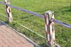 Photo of  fence in sunny day. Photo of meadow with fence in sunny day Stock Images