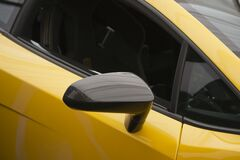 Photo of fender mirror with a fiber-reinforced housing on the Superleggera version of Gallardo. Royalty Free Stock Photos