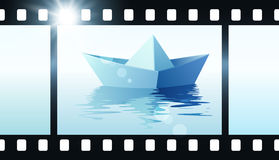 Photo film with origami boat Royalty Free Stock Photo